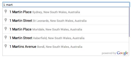 Um campo de texto com preenchimento automático e o seletor de previsões de local fornecidas à medida que o usuário digita a consulta de pesquisa: